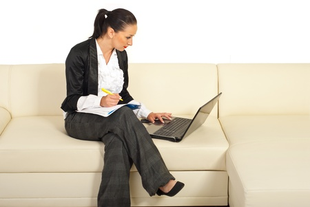 Business woman working and sitting on couch isolate don white background photo