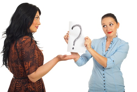 Brunette woman questioning her friend  who dont know the answer and showing question mark isolated on white background photo
