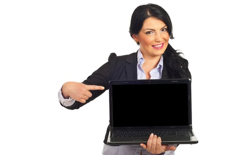 Happy business woman pointing to blank laptop screen isolated on white background Stock Photo - 9498803