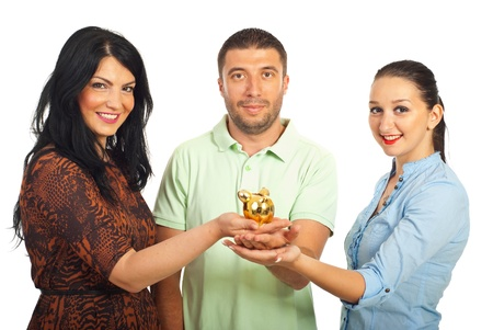 Group of three friends holding piggy bank in their hands and being united isolated on white background photo