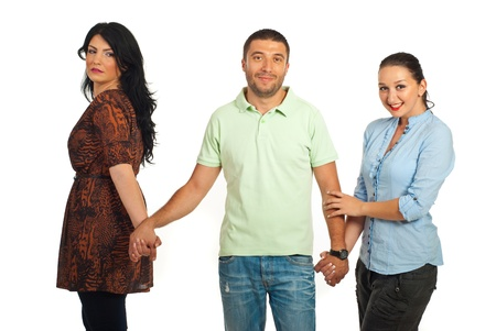 cheated: Woman cheated looking with envy face to smiling man who holding other woman hand isolated on white background