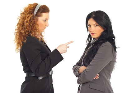 Upset manager pointing to employee woman and arguing isolated on white background photo