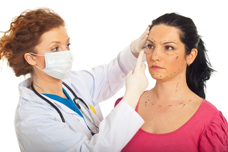 protective mask: Plastic surgeon woman with protective mask preparing and explaining to patient woman the procedure for surgery isolated on white background Stock Photo