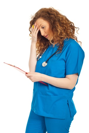medical clipboard: Tired or thinking doctor woman holding clipboard isolated on white background Stock Photo