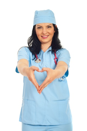 Happy doctor woman forming heart shape with her hands  in front of her body isolated on white background photo