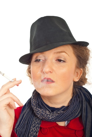 Portrait of retro redhead  woman with black hat smoking  isolated on white background photo