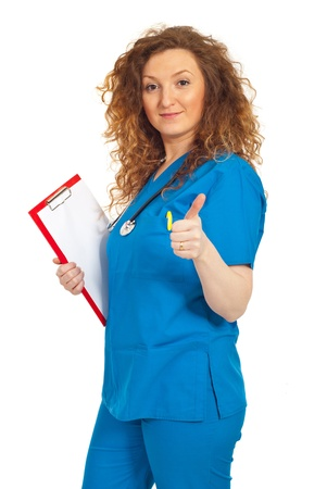 Successful doctor woman giving thumb up isolated on white background photo