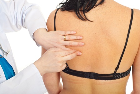 auscultation: Doctor make pulmonary percussion to patient woman back and pulmonary auscultation  Stock Photo