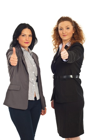 Successful two executives women giving thumbs up isolated on white background photo