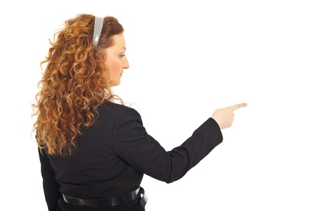 Back of business woman pointing in a side isolated on white background photo