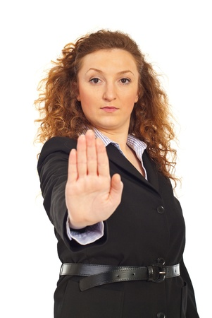 Business woman with stop hand gesture isolated on white background photo