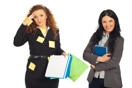 neat: Disorganized business women with folders and reminder notes on her suit and organized smiling business woman holding personal agenda isolated on white background Stock Photo