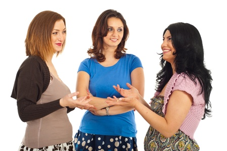 Happy group of three women having conversation and smiling isolated on white background