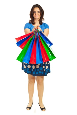 Full lnegth of smiling woman showing colorful bags isolated on white background Stock Photo - 9617484