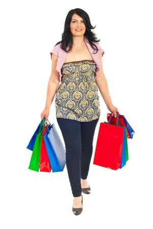 Smiling woman goinf to shop and holding shopping bags isolated on white background Stock Photo - 9617485