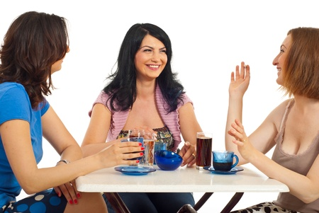 Three happy women friends having a meeting at coffee and having conversation isolated on white background