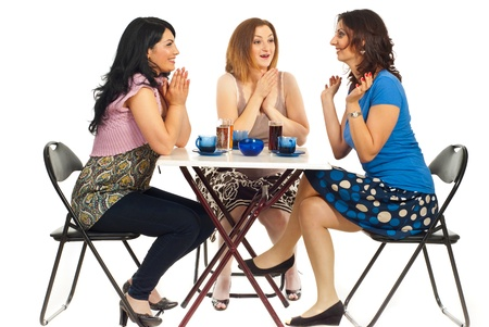 Three women sitting on chair at table in a cafe shop ,two of them congratulate or being happy for their friend with success and sharing the good news together photo
