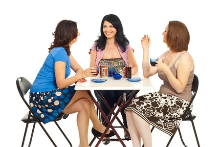 Group of three women chatting and drinking coffee in a cafe shop or home  Stock Photo
