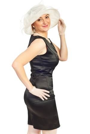 Beautiful elegant woman in satin dress ,hat and gloves isolated on white background Stock Photo - 9617539