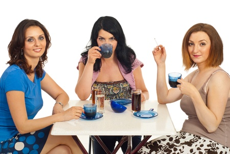 Friends women having a meeting and drinking coffee together  isolated on white background photo