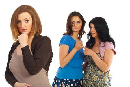 Envious two women gossip about their friend against white background photo