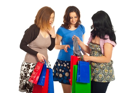 purchased: Friends women admiring what their friend purchased   and being happy isolate don white background Stock Photo