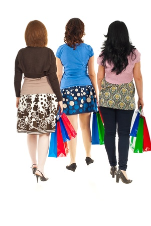 Back of three women walking at shopping isolated on white background photo