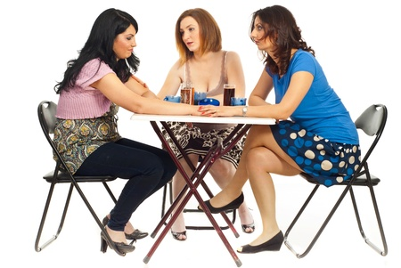Two women comforting their friend and all sitting at table over white background