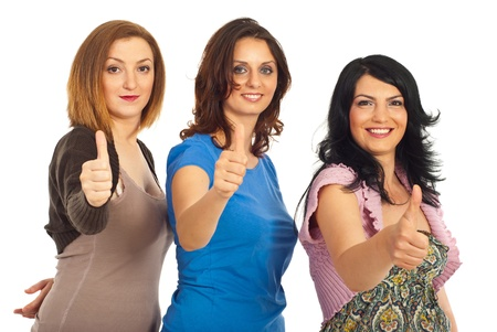 Three women friends in a line giving thumbs up isolated on white background Stock Photo