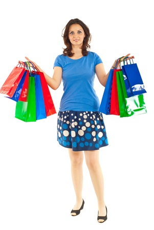 Full length of smiling woman showing shopping bags isolated on white background Stock Photo - 9665145