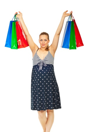 Happy pregant woman at shopping raising her hands with colorful bags isolated on white background photo