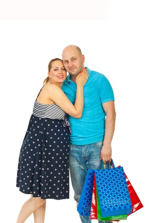 Happy future parents standing in embrace and holding shopping bags isolated on white background Stock Photo - 9729377