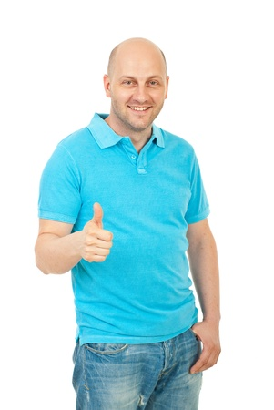 Laughing bald man with blank turquoise t-shirt giving thumb up isolated on white background photo