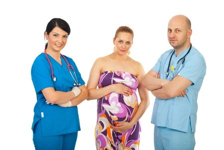 Happy team of doctors and pregnant woman isolated on white background Stock Photo - 9741279