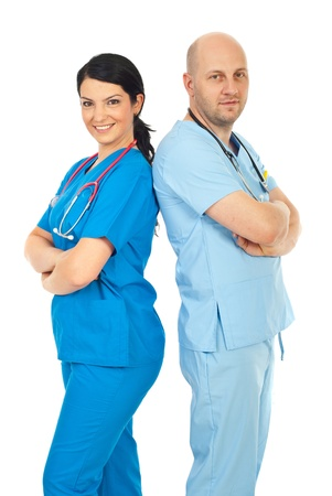 Happy team of two physicians standing back to back  with arms folded isolated on white background