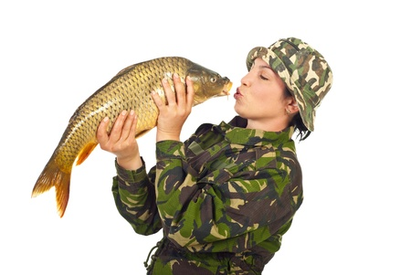 Fisher woman kissing big carp fish isolated on white background photo