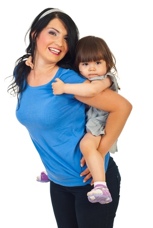 Mother giving piggyback ride to her little daughter isolated on white background photo