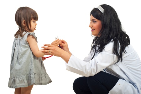 child care: Doctor woman talking with little girl and holding both stethoscopes isolated on white bckground
