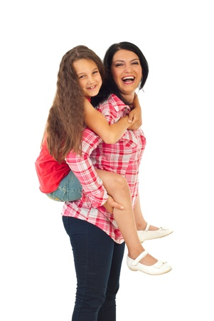 Laughing mother giving piggyback and having fun with her daughter isolated on white background