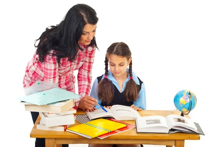 Mother or teacher woman helping girl with homework isolated on white background photo