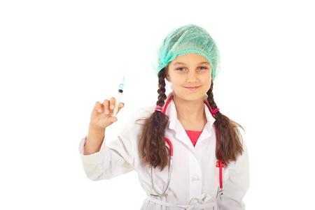 Little smiling future doctor holding syringe isolated on white background photo
