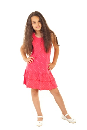 Full length of beautiful girl model in pink dress posing with hands on waist isolated on white background