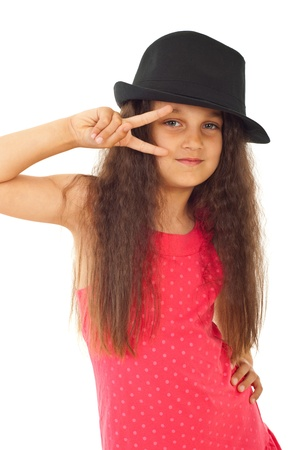 Beauty model girl with hat and long hair showing two fingers in front of her blue eyes isolated on white background photo