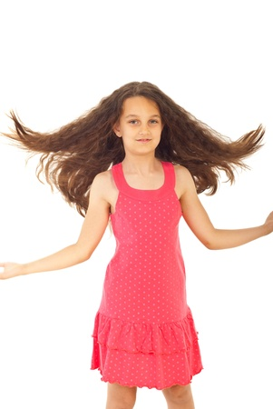 Pretty girl in pink dress flipping hair isolated on white background photo