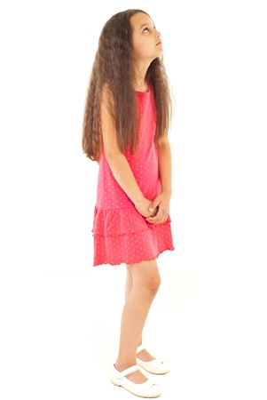 child looking up: Full length of girl with long hair looking up and waiting isolated on white background