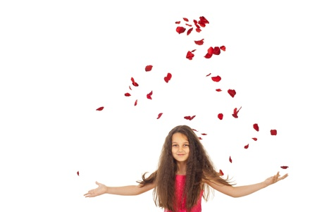 Beauty girl with flying roses  petals isolated on white background