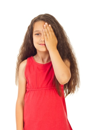 covering eyes: Girl covering one eye with palm for eyesight exam