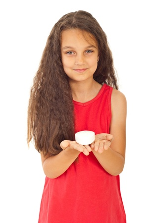 Smiling girl with long curly hair holding soap in their palms isolated on white background photo
