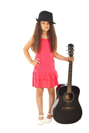 Pretty girl with black hat holding guitar isolated on white background photo