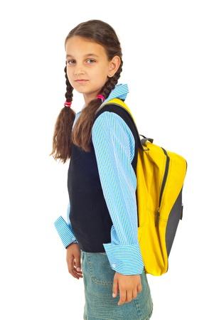 ni�os saliendo de la escuela: Colegiala de belleza con coletas y bolsa permanente en perfil semi aislado en fondo blanco